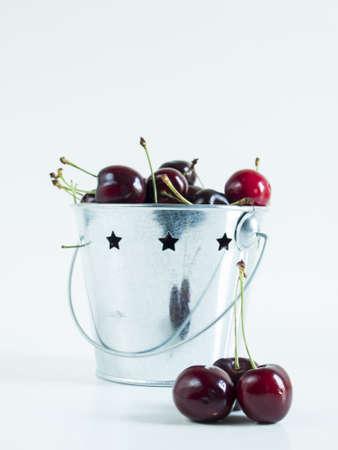 Freshly picked heap of cherries in metal bucket. Stock Photo - 14346374
