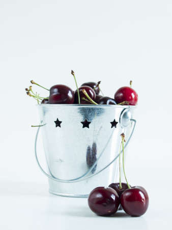 Freshly picked heap of cherries in metal bucket. Stock Photo - 14346374