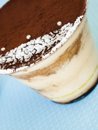 airy texture: Tiramisu mousse with custom decoration served in plastic cup. Stock Photo