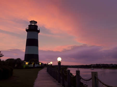 This lighthouse is located in Light Keepers Village, Cogulna Harbor, Little River, SC photo