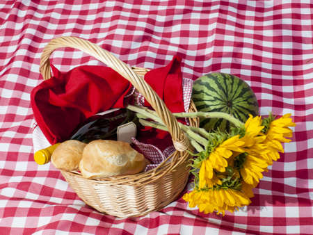 Picnic basket with fresh bread and wine. photo