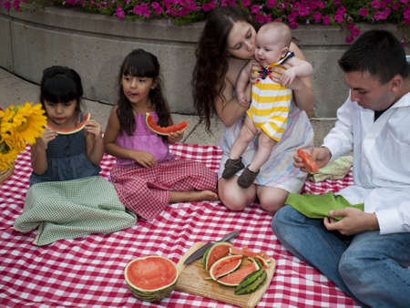 Young family having picnic at the park. photo