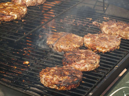Gourmet hamburger parries on the grill. photo