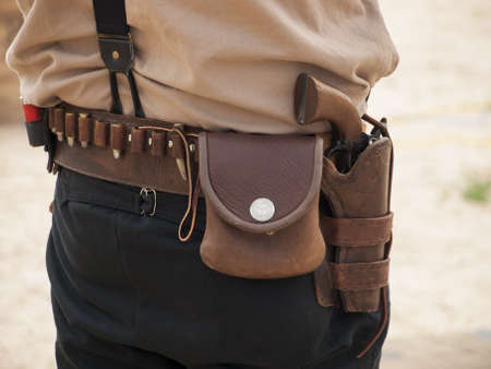existed: 2012 annual match of Colorado Shaketails Cowboy Action Shooting SASS Club.  The firearms used are based on those which existed in the 19th century American West, i.e. lever action rifle, single action revolver, and shotgun.