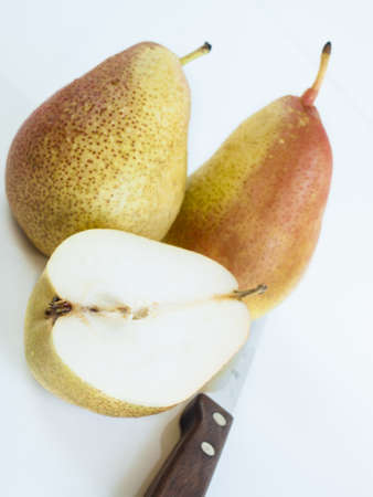 antiquity: Ripe pear on white background. The cultivation of the pear in cool temperate climates extends to the remotest antiquity, and there is evidence of its use as a food since prehistoric times.