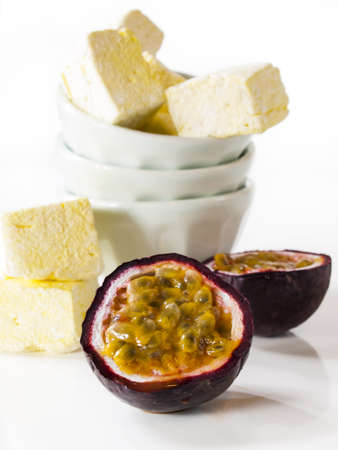 Gourmet passion fruit marshmallows on white background. photo