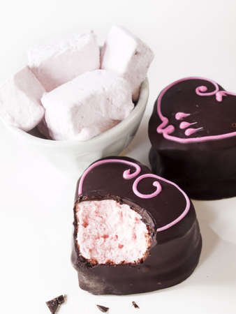 Gourmet chocolate covered strawberry marshmallows on white background. photo
