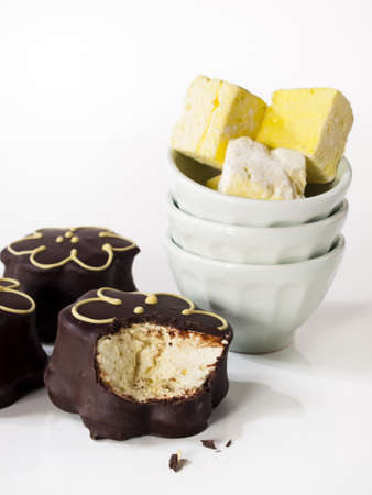 Gourmet chocolate covered passion fruit marshmallows on white background. photo