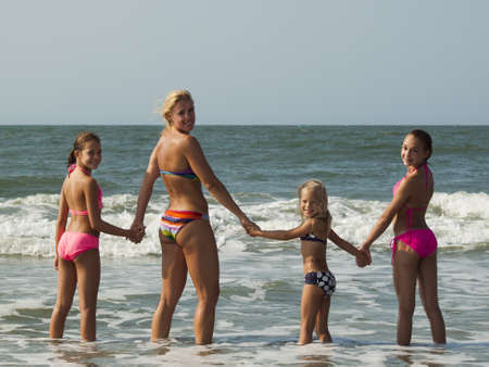 kids playing beach: Myrtle Beach is a coastal city on the east coast of the United States in Horry County, South Carolina.