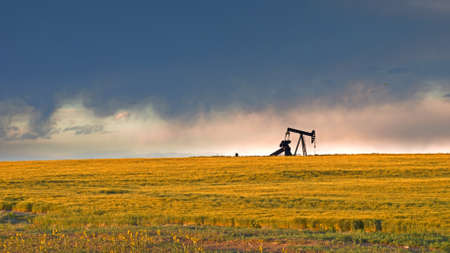 prairie: A pumpjack silhoutte with dramatic sunset.