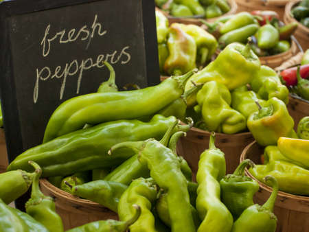 organic peppers sign: Fresh organic food at the local farmers market. Farmers markets are a traditional way of selling agricultural products.
