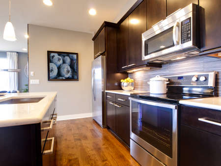 home appliances: Modern kitchen with wood cabinets and stainless appliances.