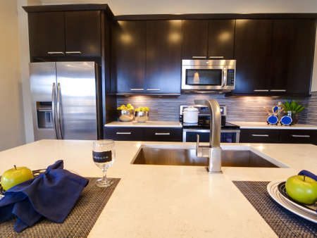 appliances: Modern kitchen with wood cabinets and stainless appliances.