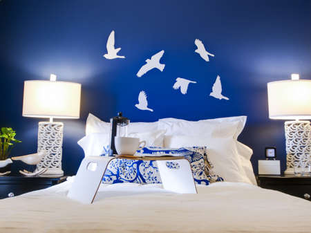 master bedroom: Modern master bedroom with blue wall and white linens.