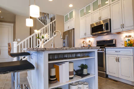 Modern kitchen with white cabinets and stainless appliances. Stock Photo - 15079395