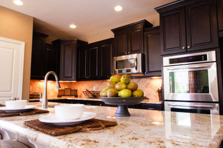 Modern kitchen with dark wood cabinets and hardwood floors. Stock Photo - 15079363