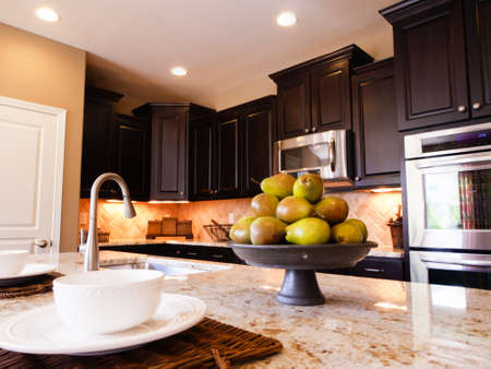 Modern kitchen with dark wood cabinets and hardwood floors. Stock Photo - 15079383