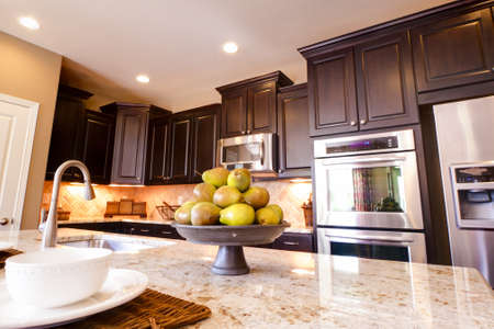 Modern kitchen with dark wood cabinets and hardwood floors. Stock Photo - 15079415