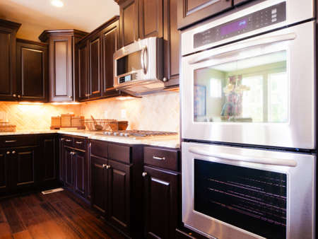 Modern kitchen with dark wood cabinets and hardwood floors. Stock Photo - 15079434