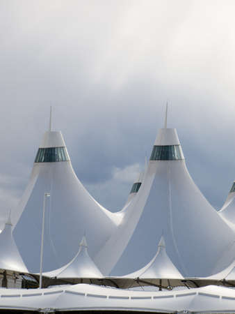 well known: Denver International Airport well known for peaked roof  Design of roof is reflecting snow-capped mountains