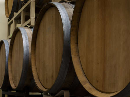 Wine barrels stacked in cellar area of vinery in Palosade, Colorado. photo