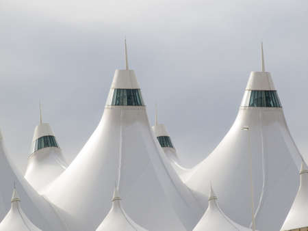 peaked: Denver International Airport well known for peaked roof. Design of roof is reflecting snow-capped mountains. Editorial