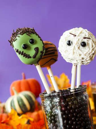 Halloween gourmet cake pops with purple backround.