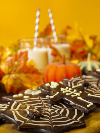 webb: Halloween gourmet cookies with holiday decor orange background.