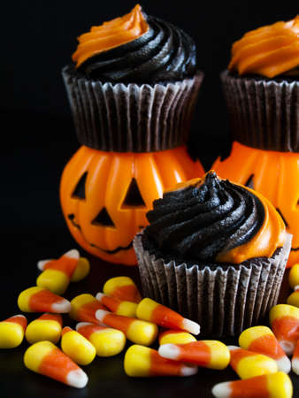 patty cake: Halloween cupcakes decorated with black and orange swirled icing. Stock Photo
