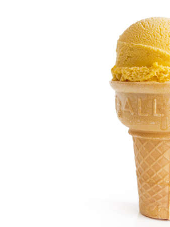 Scoop of gourmet pumpkin gelato in cake cone on white background. photo