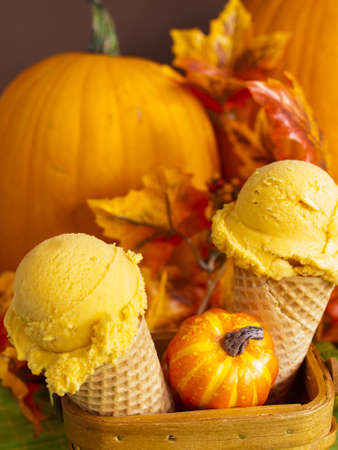 Scoop of gourmet pumpkin gelato in waffle cones.