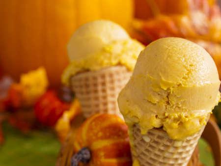 Scoop of gourmet pumpkin gelato in waffle cones. photo
