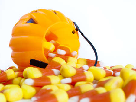 falling out: Candy corn candies falling out of Halloween treat bag. Stock Photo