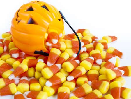 Candy corn candies falling out of Halloween treat bag. Stok Fotoğraf