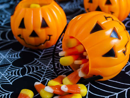 Candy corn candies falling out of Halloween treat bag. photo