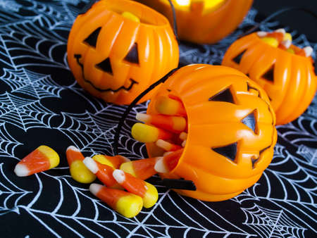 candy corn: Candy corn candies falling out of Halloween treat bag. Stock Photo
