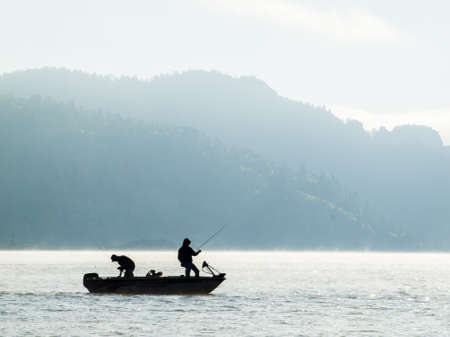 Early morning fishing from the boat in Autumn. Editorial