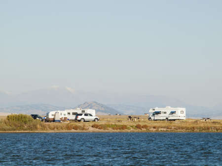 Motorhome campsite near the lake on early morning late in the season.
