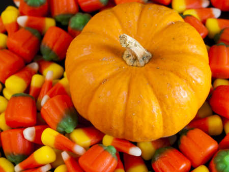 candy corn: Halloween candy corn and pumpkin candies on black background. Stock Photo