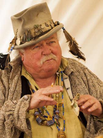 settler: Early American settler in old-fashioned clothing. 2012 Pumpkin Harvest Festival at Four Mile Historic Park, Denver. Editorial