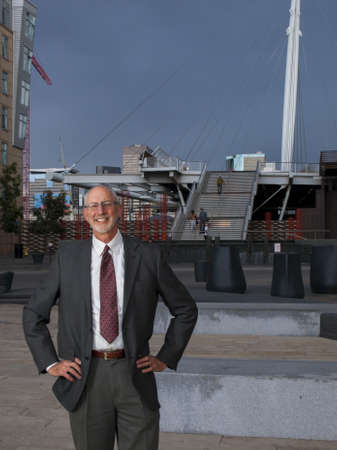 Businessman posing to the camera on plaza in the urban area. 2012 ULI Fall Meeting in Denver, Colorado. 2012 ULI Fall Meeting in Denver, Colorado. Stock Photo - 15650187
