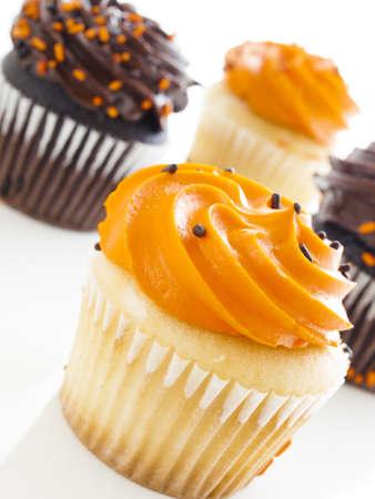 Halloween orange and black cupcakes on white background. photo