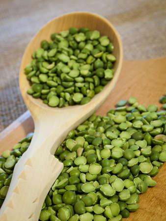 Green speat peas in wooden spoon. Reklamní fotografie