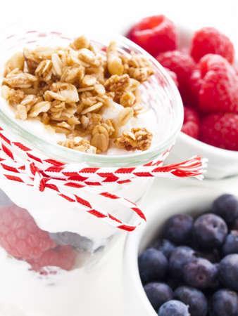 Delicious fruit, greek yogurt and granola parfaits on white background Reklamní fotografie