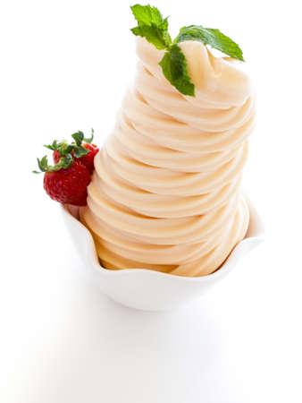 frozen yogurt: Cup of soft-serve frozen yogurt on white background.