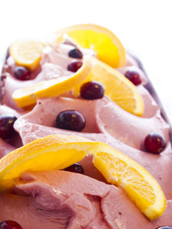 nonfat: Gourmet sweet orange and cranberry gelato on white background. Stock Photo