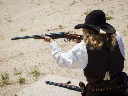 2012 annual match of Colorado Shaketails Cowboy Action Shooting SASS Club.  The firearms used are based on those which existed in the 19th century American West, i.e. lever action rifle, single action revolver, and shotgun. photo