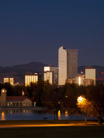 denver skyline with mountains: Sunrise over downtown Denver in late Autumn. Stock Photo