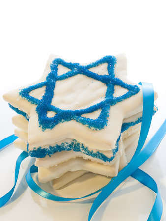 shield of david: Gourmet cookies decorated with white icing for Hanukkah.