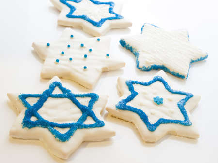 Gourmet cookies decorated with white icing for Hanukkah. photo